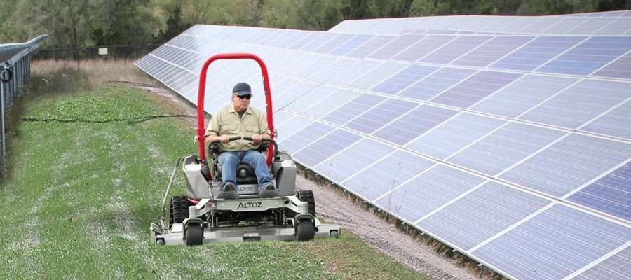 Tracked zero turn mower at solar farm