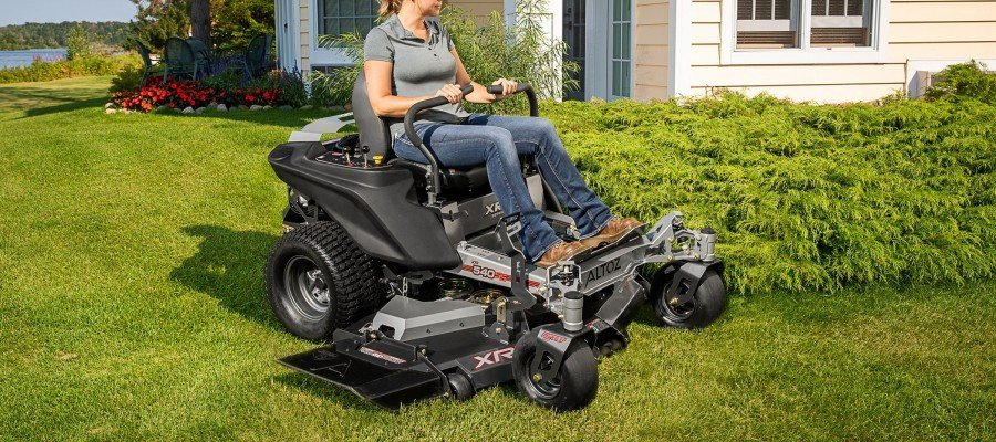 woman on zero turn lawn mower